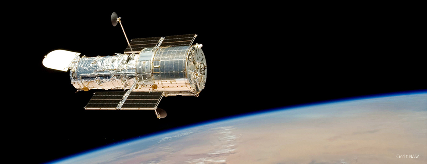 The Hubble Space Telescope: From Cosmological Conflict to Alien Atmospheres